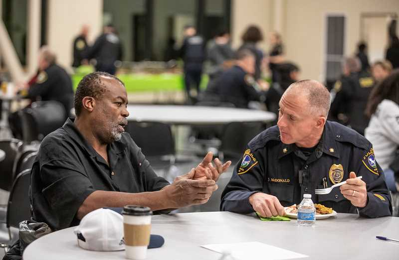 TIMES PHOTO: JONATHAN HOUSE - Tigard business owner David Raines chats with Tigard Police Commander Jamey McDonald during the No Hate Zone Community Dinner.