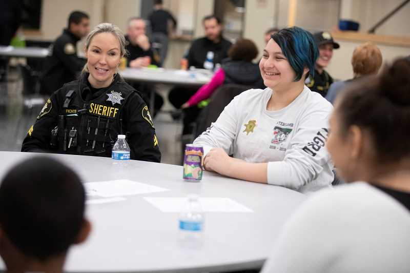 TIMES PHOTO: JONATHAN HOUSE - Washington County Corporal Theresa Fichter chats with Jackson Fisk and other Tigard Mentors during the No Hate Zone Community Dinner.