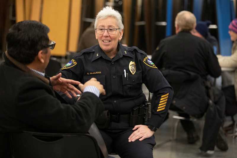 TIMES PHOTO: JONATHAN HOUSE - Tigard Police Chief Kathy McAlpine chats with an attendee at a Monday night Community Dinner between underrepresented members of the community, Tigard police officers and Washington County sheriff's deputies, held at the parish hall at St. Anthony's Catholic Church in Tigard.