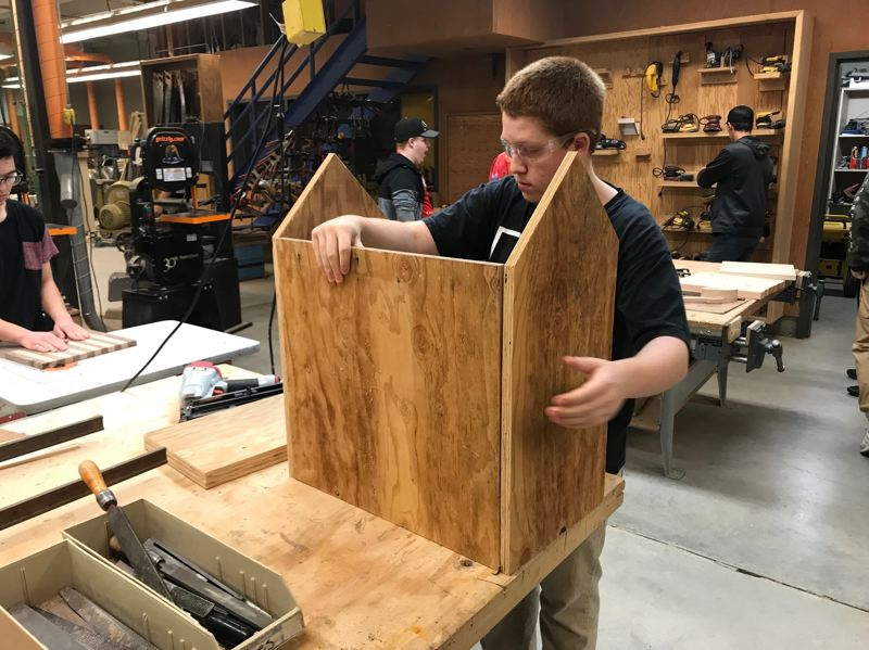 PHOTO COURTESY OF THE CITY OF ST. HELENS - Justin Waid, a junior at St. Helens High School, works on the construction of the library book box he designed for the Little Free Library placed in St. Helens. The library was installed at Grey Cliffs Waterfront Park and a dedication ceremony was held Saturday, Feb. 2.