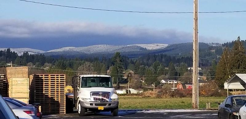 PHOTO COURTESY OF MICHAEL LOUIS CAVALLO - This reader-submitted photo taken in south Scappoose shows a light dusting of snow in the hills on Tuesday, Feb. 5. While the area received a light dusting during the week, another winter weather front in expected to hit the region this weekend.