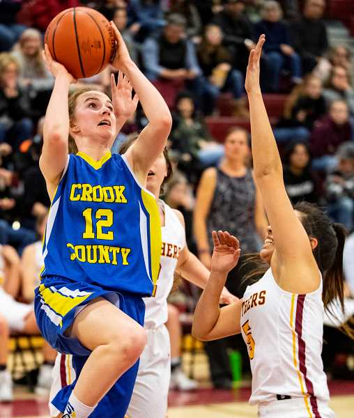 LON AUSTIN/CENTRAL OREGONIAN - Dallas Hutchins goes up for two of her 14 points during the Cowgirls 63-37 loss to the Redmond Panthers Tuesday night. Hutchins also led the Cowgirls in rebounding with six.