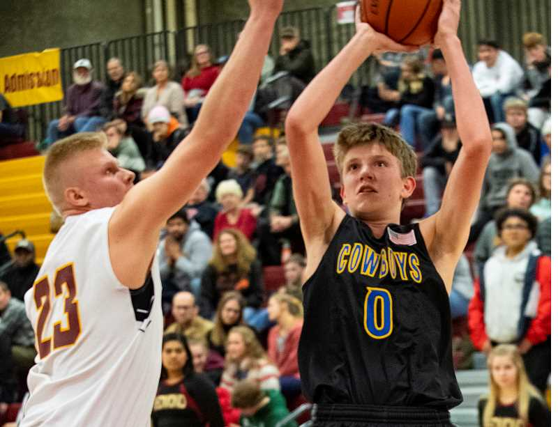 LON AUSTIN/CENTRAL OREGONIAN - Cayden Lowenbach goes up for two of his six points in the Cowboys' loss to Redmond on Tuesday night. Crook County led 43-42 late in the game, before falling 56-49 to the Panthers.