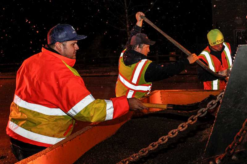 STAFF FILE PHOTO - Crews with Hillsboro's Public Works Department are preparing to work 'around the clock' plowing city streets. Several inches of ice and snow are expected in the next several days.