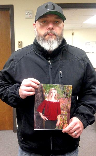 OREGON CAPITAL BUREAU: CLAIRE WITHYCOMBE - Jason Wilson holds a photo of his daughter, Chloe, who died a year ago. Wilson supports legislation to prevent school violence and fight student suicide.