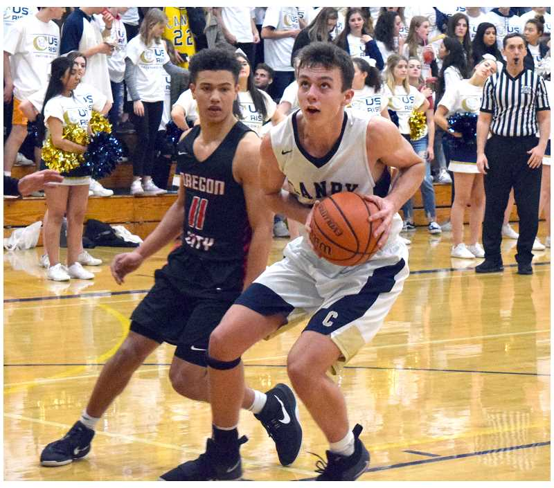 HERALD PHOTO: TANNER RUSS - Canby sophomore Ben Bailey led the Cougars in scoring with 10 points. The Cougars were defeated by Oregon City a second time, this time by 55-35.