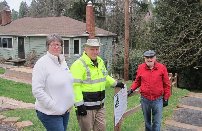 Debbie Small, Don Baack and Glenn Bridger at the site of a trail that was completed a year ago.