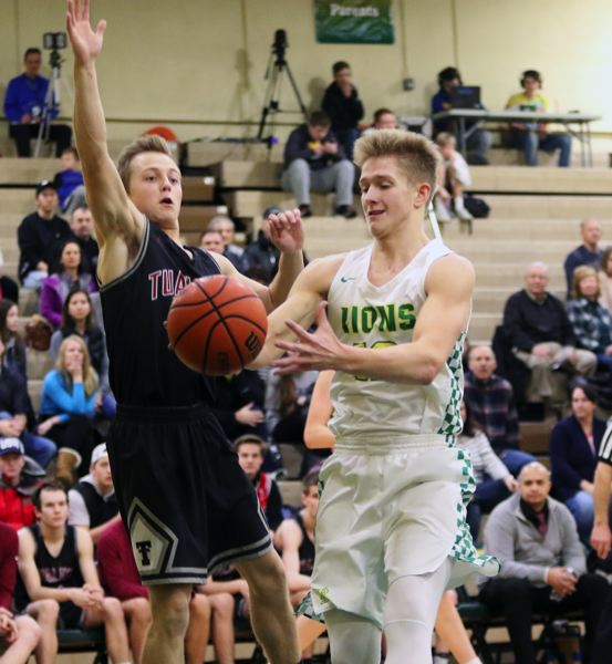 TIMES PHOTO: DAN BROOD - West Linn junior Parker Durbin (right) looks to grab the ball in front of Tualatin senior Caden Dickson during Friday's game.
