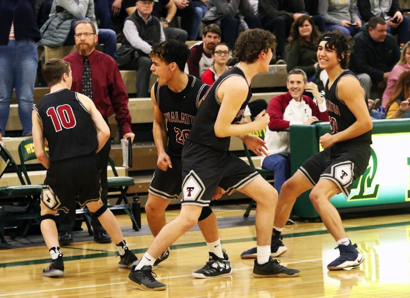 TIMES PHOTO: DAN BROOD - Tualatin's (from left) Derek Leneve, John Miller, Logan Shaw and Bridger Steppe celebrate following the 44-42 overtime win at West Linn on Friday.