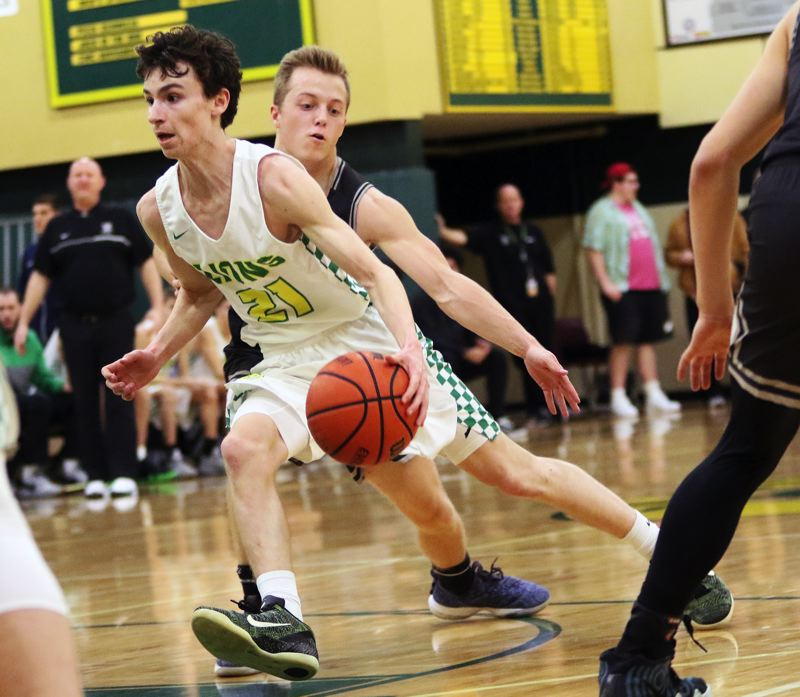 TIMES PHOTO: DAN BROOD - West Linn junior Kelton Herrick (21) looks to get past Tualatin senior Caden Dickson during Friday's game.