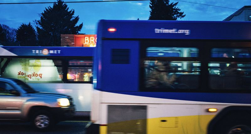 VIA TRIMET - TriMet buses at night are shown here.