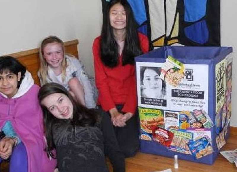 SUBMITTED PHOTO - These girls at St. Barnabas school decorated their school's SW Hope barrels.