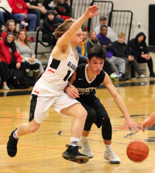 PAMPLIN MEDIA: JIM BESEDA - Corbett guard Dylan Paintner  collides with Matthew Lehrbach during the Cardinals 66-64 road win Friday.