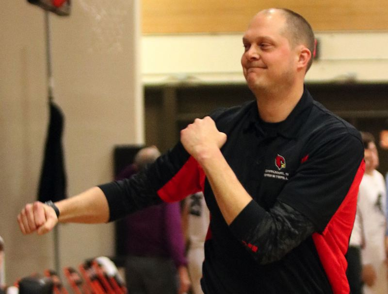 PAMPLIN MEDIA: JIM BESEDA - Corbett coach Don Carter gives a celebratory fist pump as time expires in the Cardinals' 66-64 win at Gladstone on Friday.