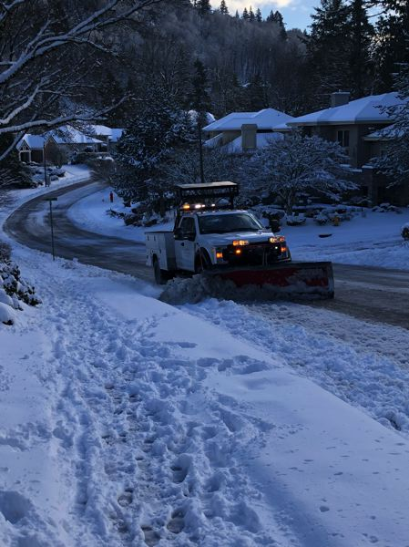 PAMPLIN MEDIA GROUP FILE PHOTO - A snow plow clears Gresham streets Saturday after a storm dropped about four inches of snow on the area. Monday morning, however, the snow had turned to rain and most schools were open.