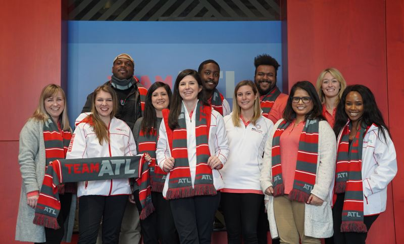 COURTESY: SPARKLOFT MEDIA - Sparkloft managed the social media team dealing with hospitality in the city of Atlanta for Super Bowl LIII. (Front Row, L to R) Lizzy Duffy, Meredith Almond, Madison Blankenship, Mandi Cox, Jaclyn Osterloh, Devika Agnihotri, Bahati Mwangoji. (Back Row, L to R) Christopher Moore, Dakari Dunning, Britt Lyle II, Nicole Weinbender.
