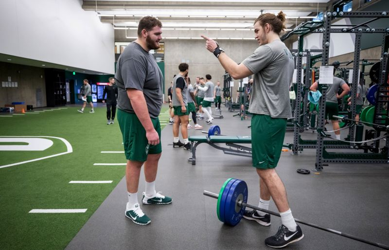 TRIBUNE PHOTO: JONATHAN HOUSE - New Portland State offensive lineman John Krahn (left), 6-10 and 400-some pounds, works out with another sizable Viking, 6-8, 260 tight end Daniel Giannosa.