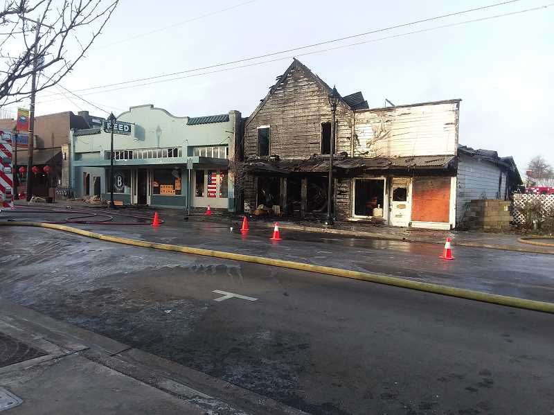 SANDY STOREY - Pictured are the damaged buildings on Thursday after the fire.