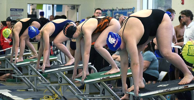 PAMPLIN MEDIA GROUP PHOTO: TANNER RUSS - Scappoose's Maddy Thorne (second from right) gets ready to launch into a race during the NWOC district swim meet at Parkrose High School on Friday.