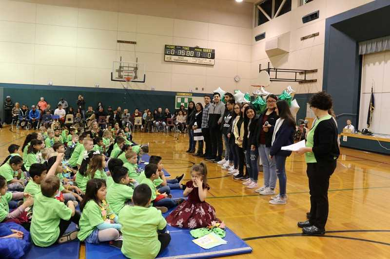 COURTESY PHOTO: TROST ELEMENTARY - At the ceremony, 12 bilingual seniors from Canby High School talk about what is special about being bilingual.