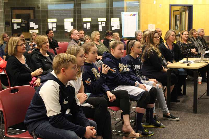KRISTEN WOHLERS - Knight Elementary staff and student peer mediators present the new program before the board at the January school board meeting.