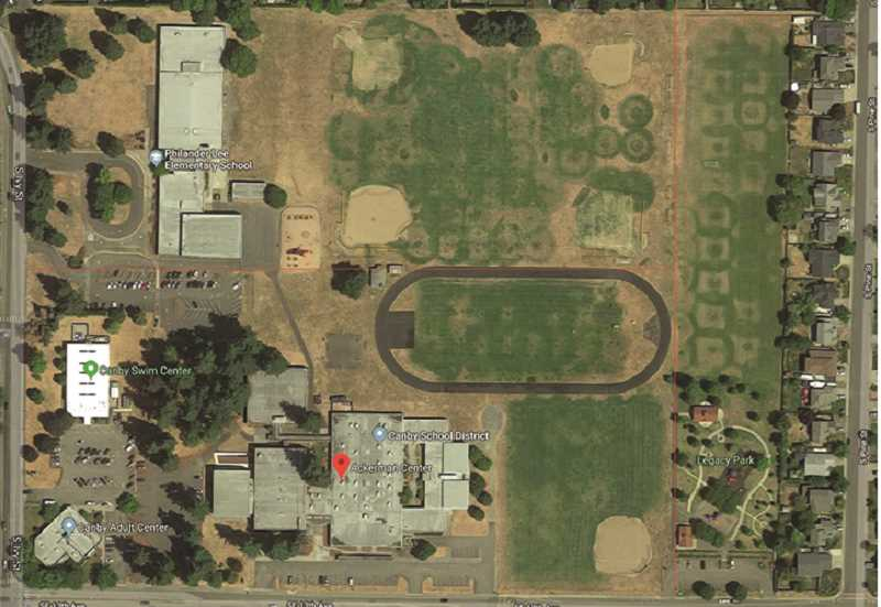 An aerial view of the Ackerman Field area shows the open space potentially available for the complex. The faint red lines indicate the three tax lots, with the easternmost lot belonging to the City and the two large western lots owned by the school district.