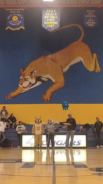 PMG PHOTO: PHIL HAWKINS - While applying to work at Gervais High School in 1969, Jeannine James recalls being shown the Cougar mural in the gymnasium, which was painted just several years prior.