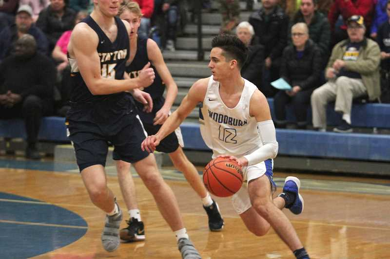 PMG PHOTO: PHIL HAWKINS - Despite hitting the 2,000-point mark in front of a home crowd on Friday, Veliz was less interested in personal accolades this season as he focuses on the Bulldogs goal of bringing a state championship home to Woodburn.