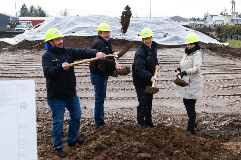 STAFF PHOTO: CHRISTOPHER OERTELL - The Wrobel family, Jon, Hans, Rhonda and Abe throw dirt during the groundbreaking ceremony for the new facility.