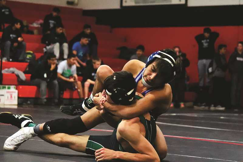 COURTESY: KADEN CHRISTIANSEN - Woodburn sophomore Wesley Vasquez picked up this first round victory over North Marions Martin Pacheco en route to winning the 113-pound district title. Vasquez was one of seven Woodburn wrestlers to qualify for state, while the Huskies will send four to state.