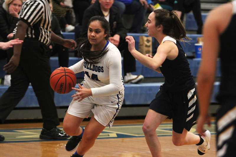 PMG PHOTO: PHIL HAWKINS - Woodburn senior Jocelyn Santillan turns the corner in the first half as the Bulldogs rallied from a 24-0 deficit to post an 11-0 run against the No. 7 Stayton Eagles.