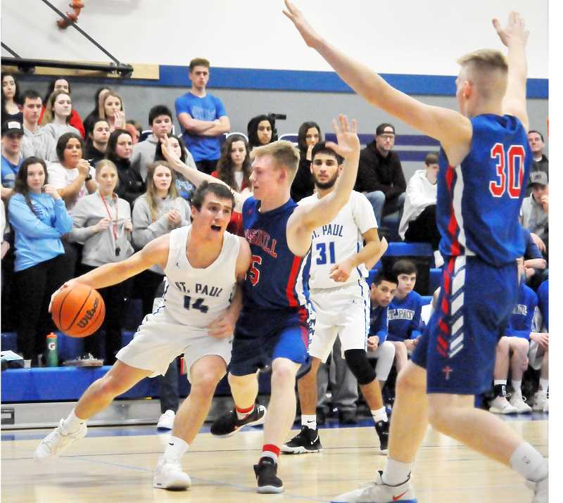 GARY ALLEN - Senior Justin Herberger drives into a pair of Crosshill Christian defenders in a 74-56 loss for the Bucks on Friday.