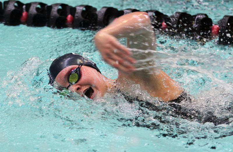 REVIEW PHOTO: MILES VANCE - Lake Oswego senior Madeline Eller cuts through the water on her way to a fourth-place finish in the 500-yard freestyle at the Three Rivers League district swim meet at Mt. Hood Community College Aquatic Center on Friday.