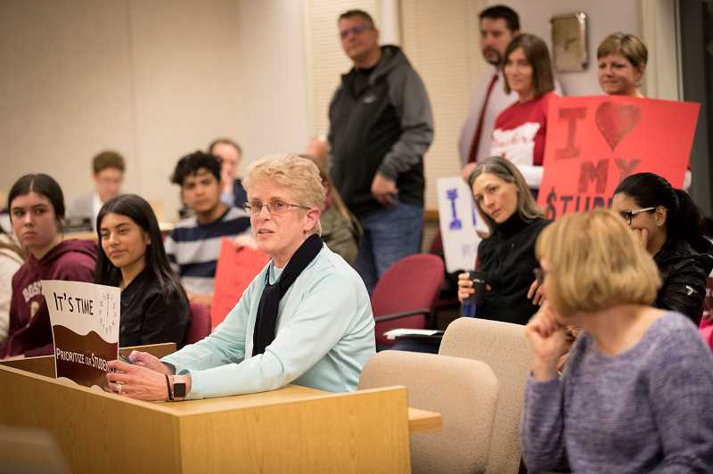 TIMES PHOTO: JAIME VALDEZ - A member of the Tigard-Tualatin Education Association testifies in front of the Tigard-Tualatin School Board Monday night in support of a joint resolution asking for more funding for Oregon schools.