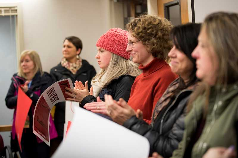 TIME PHOTO: JAIME VALDEZ  - Teachers rally to show support for a joint resolution between the Tigard-Tualatin Education Association and the Tigard-Tualatin School Board Monday night.