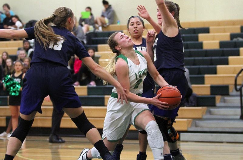 TIDINGS PHOTO: MILES VANCE - West Linn junior guard Cami Fulcher drives through the Canby defense to score during her team's 75-51 win over Canby on Tuesday at West Linn High School.