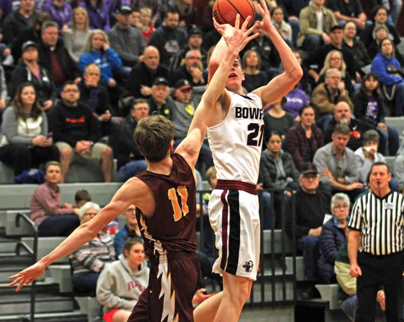 PMG PHOTO: WADE EVANSON - Sherwood High School senior Braden Thorn (right) shoots a jump shot over Forest Grove senior Henry Tonges during Fridays game.