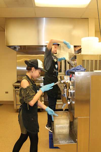 SPOKESMAN PHOTO: HOLLY BARTHOLOMEW - Jr. Scoop students use the club's ice cream machines to make ice cream.