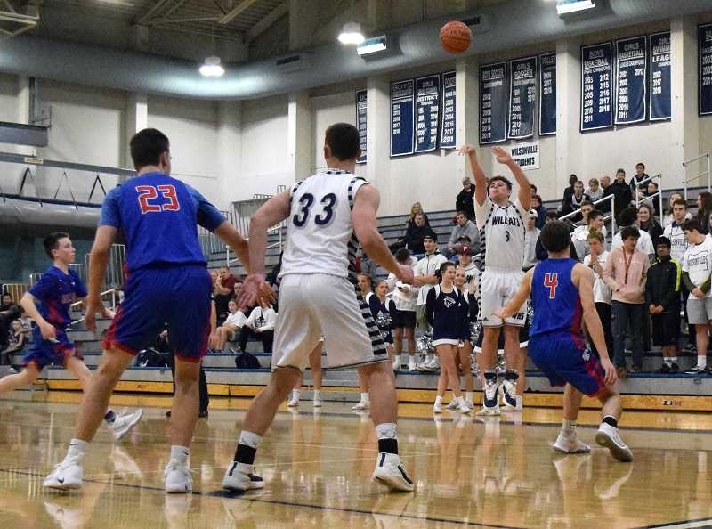 SPOKESMAN PHOTO: TANNER RUSS - Senior Jack Roche puts up a shot from beyond the 3-point line. Roche had 16 points in the game.