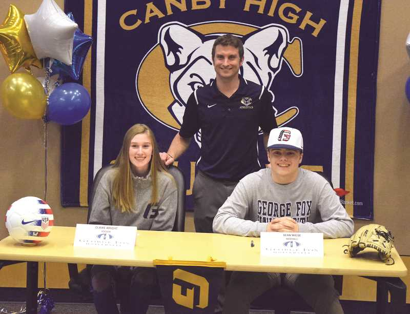 HERALD PHOTO: TANNER RUSS - Canby seniors Claire Wright and Sean Wiese with Canby interim athletics director Ben Winegar.