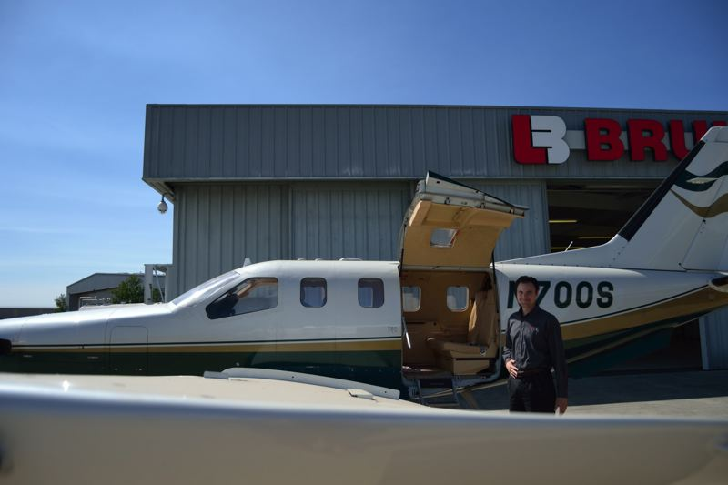 TRIBUNE PHOTO: JULES ROGERS - Devinaire, a charter plane service currently based in Hillsboro, will move its storage and maintenance operations to Scappoose. The company plans to occupy a nearly 30,000-square foot hangar being built by the Port of Columbia County.