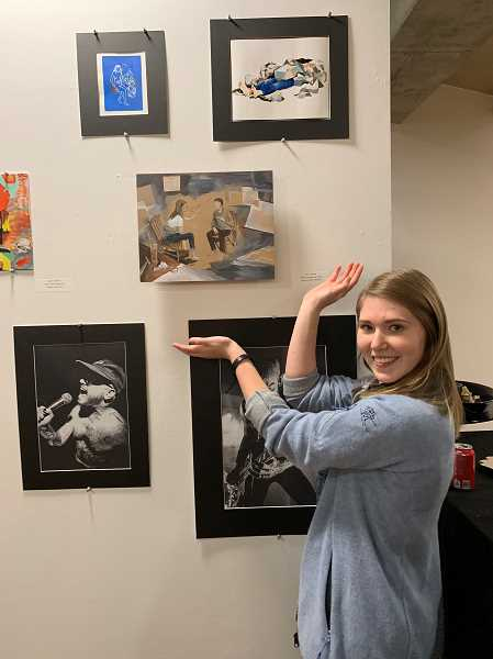 SUBMITTED PHOTO: SHANNON MCBRIDE - Lakeridge student Nicole Konicke shows off one of her Gold Key-winning works at the awards reception.