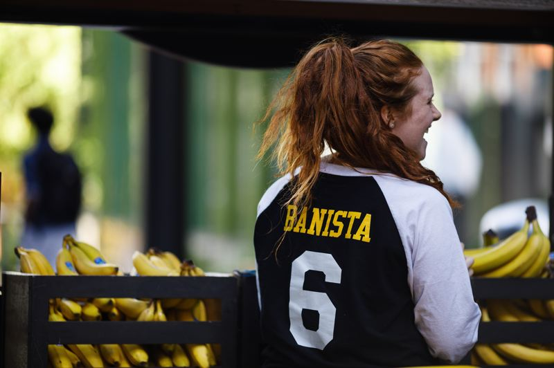 COURTESY: AMAZON.COM - A 'banista' serving bananas to staff at Amazon's Seattle HQ. New York City won't be getting HQ2, and nor will Portland be reviving its bid to lure the e-tailer here.