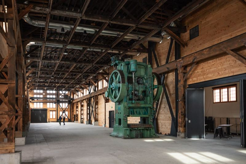 TRIBUNE PHOTO: JONATHAN HOUSE - The old metal press still sits in the main meeting room of this former foundry, adding some industrial chic to otherwise exclusively white-collar world.