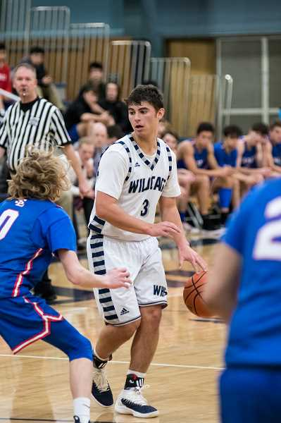 SUBMITTED PHOTO: GREG ARTMAN - Senior Jack Roche surpassed 1,000 points in his high school career, joining seven other Wildcats over the years in reaching that milestone.