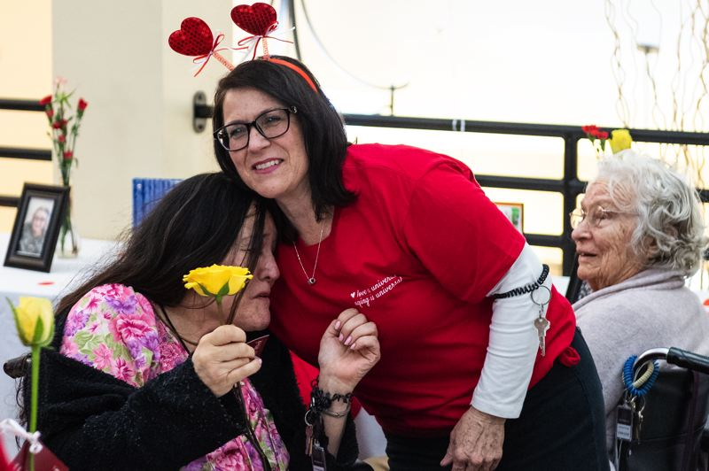 STAFF PHOTO: CHRISTOPHER OERTELL - Volunteers handed out roses to seniors at Marquis Forest Grove Post Acute Rehab and assisted living facilities on Valentine's Day, Thursday, Feb. 14.