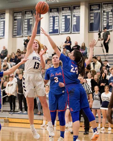 PAMPLIN MEDIA GROUP PHOTO: JAIME VALDEZ - Wilsonvilles Sydney Burns (13) shoots over La Salles Mia Skoro in a league game at Wilsonville High.