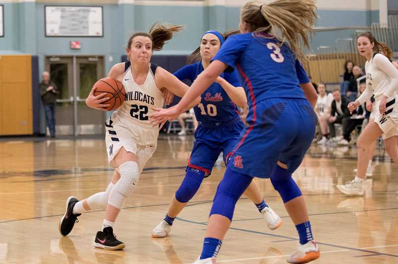 PAMPLIN MEDIA GROUP PHOTO: JAIME VALDEZ - Wilsonvilles Cydney Gutridge (22) drives on La Salle in a league game at Wilsonville High.