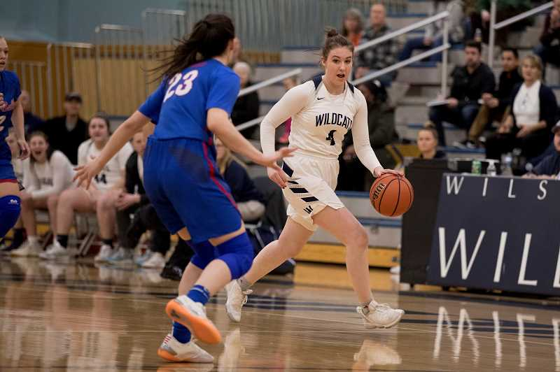 PAMPLIN MEDIA GROUP PHOTO: JAIME VALDEZ - Wilsonvilles Teagan McNamee (4) dribbles up-court against La Salles Mia Skoro (23) in a league game at Wilsonville High.