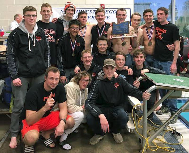 PHOTO COURTESY: DAVID RICHMOND - Scappoose coach David Richmond (bottom left) and his team pose with their trophy after winning the NWOC district swim meet.